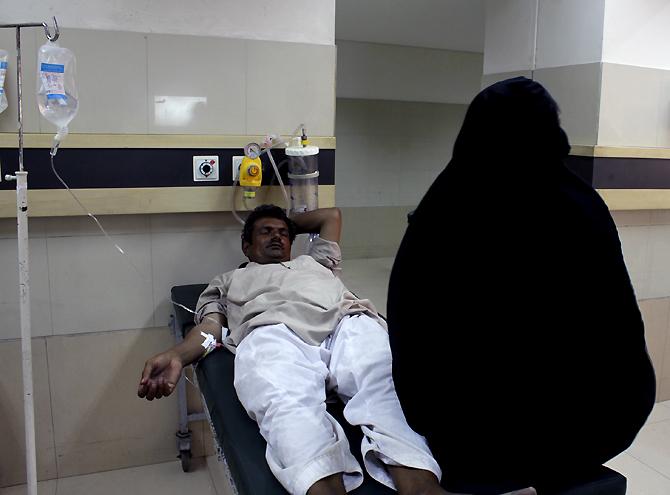 A patient undergoes treatment in the emergency ward of the Jinnah Postgraduate Medical Centre in Karachi. – Photos by Sara Faruqi/Dawn.com