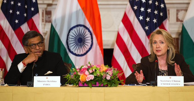 US Secretary of State Hillary Clinton (R) speaks with Indian Minister of External Affairs S.M. Krishna during the US-India Strategic Dialogue at the State Department in Washington, DC  – Photo by AFP