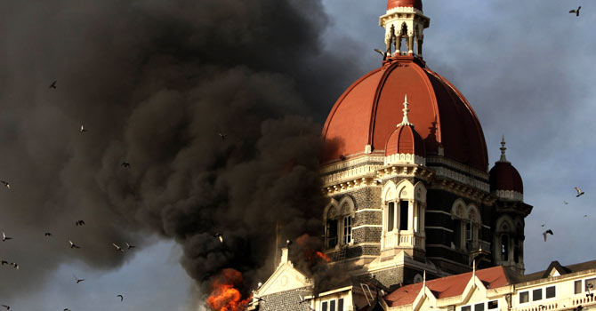 A photograph taken on November 27, 2008, shows flames gushing out of The Taj Mahal Hotel in Mumbai, one of the sites attacked by alleged militant gunmen. — File photo by AFP