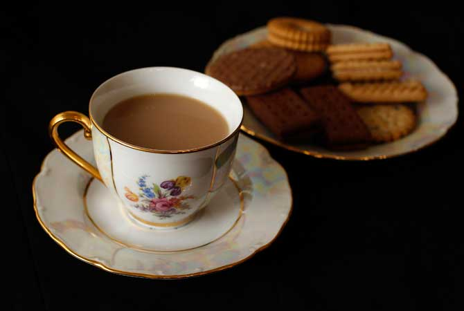 A cup of tea and plate of biscuits