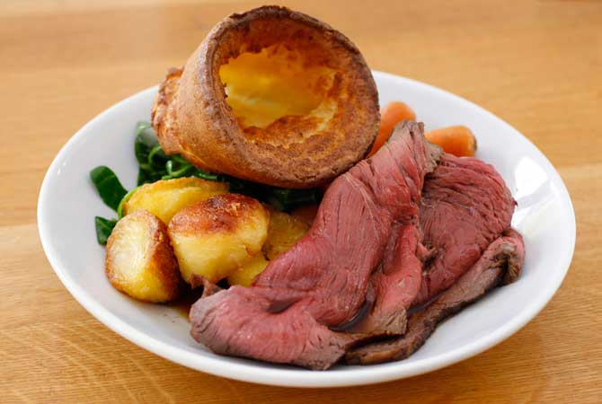A traditional British Sunday lunch of roast beef and yorkshire pudding