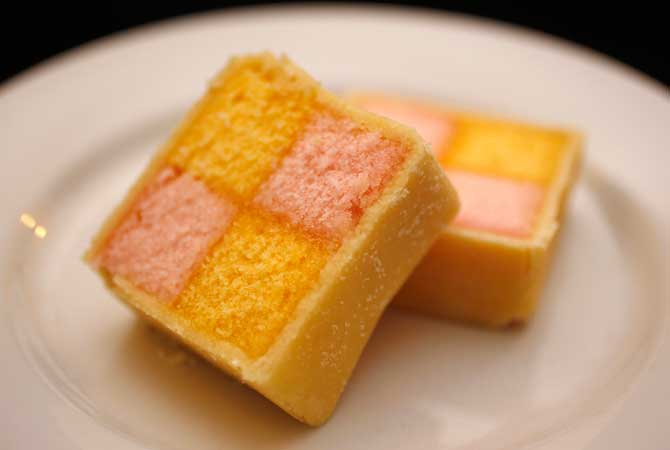 A traditional British cake made of different coloured squares of sponge covered in marzipan, called a Battenberg cake