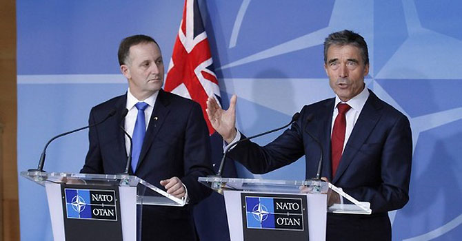 New Zealand's Prime Minister John Key (L) and NATO Secretary General Anders Fogh Rasmussen hold a news conference after signing the Individual Partnership Cooperation Programme at the Alliance Headquarters in Brussels June 4, 2012. REUTERS/Sebastien Pirlet  (BELGIUM - Tags: POLITICS)
