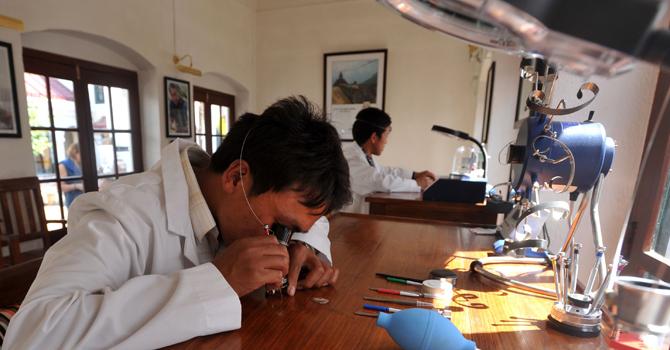 Nepalese watchmakers Ang Namgel Sherpa and Lakpa Thundu Sherpa work on timepieces at the Kobold watch workshop in Kathmandu.—AFP Photo