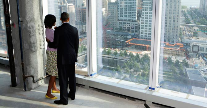 U.S. President Barack Obama and first lady Michelle Obama look down at the 9/11 Memorial  - Reuters
