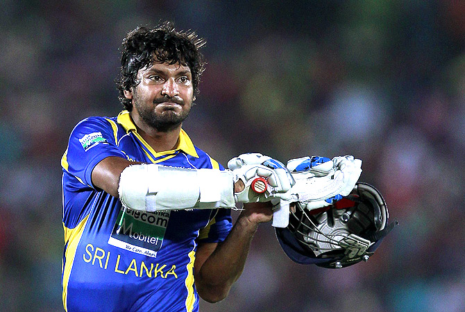 Sri Lanka's Kumar Sangakkara walks off the field after his dismissal. -Photo by Reuters