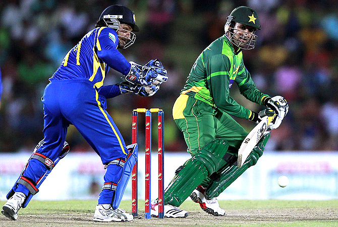 Pakistan's Shoaib Malik (R) plays a shot. -Photo by Reuters