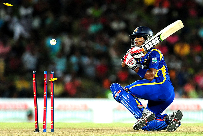 Sri Lanka's cricketer Dinesh Chandimal gets dismissed. -Photo by AFP