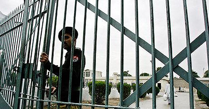 A Pakistani policeman guards a jail entrance. – File photo