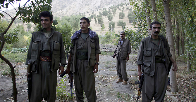 PKK fighters stand near the Qandil mountains near the Iraq-Turkish border