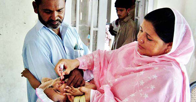 Polio vaccines being administered in Pakistan. – File photo by APP
