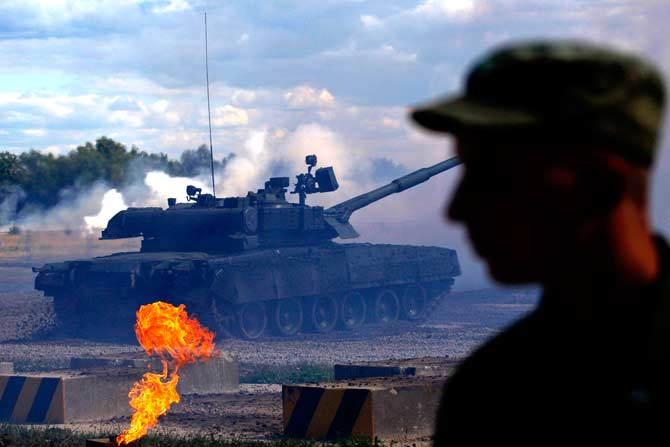 "A Russian T-80 tank is driven at a firing ground during a demonstration show, part of the ""Engineering Technologies 2012"" forum, in Zhukovsky outside Moscow. ? Photo by Reuters"