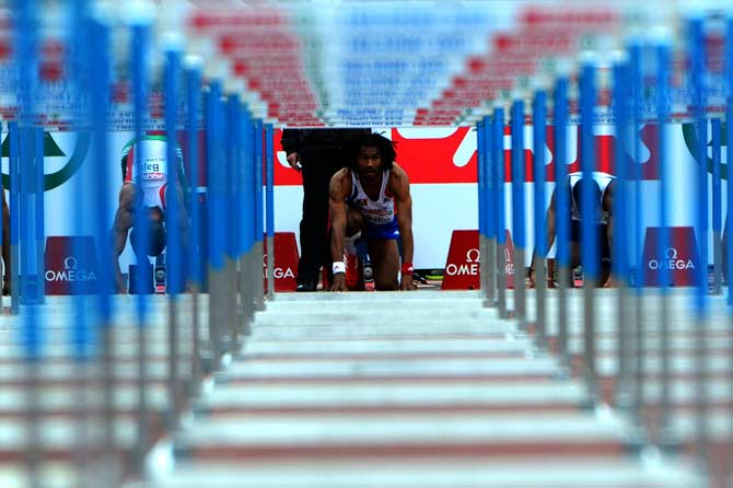 France's Samuel Coco-Viloin prerpares before the men's 110 m hurdles qualifications at the 2012 European Athletics Championships at the Olympic Stadium in Helsinki. ? Photo by AFP