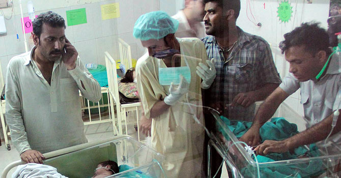 Hospital staff tend to infants following the fire that broke out in the Services Hospital in Lahore. – Photo by Online