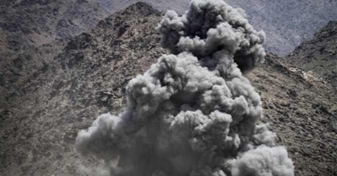 Smoke rises after a coalition air strike in Afghanistan.—AP Photo