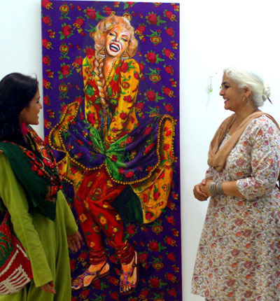 Artist Summaiya Jillani with her Marilyn acrylic titled Baar baar dekho, hazaar baar dekho, at a recent exhibit at the VM Art Gallery in Karachi. – Photo by Salman Jillani/Hosh media