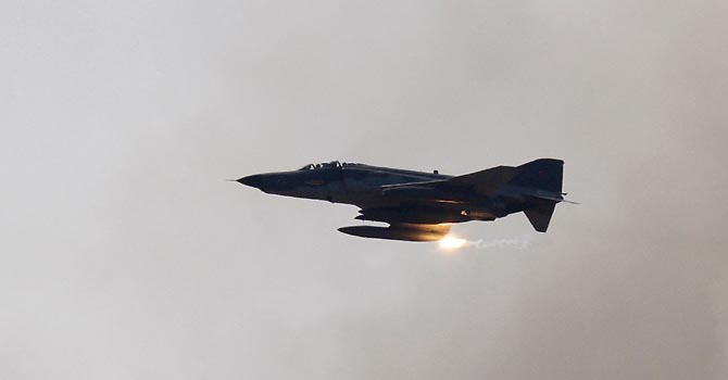 A Turkish Air Force F-4 war plane fires during a military exercise in Izmir, in this May 26, 2010 file photo. Turkey lost a F-4 warplane, similar to the one pictured, over the Mediterranean on June 22, 2012, but Turkish Prime Minister Tayyip Erdogan said in his first public comments, he could not say whether the plane had crashed or been shot down.  REUTERS