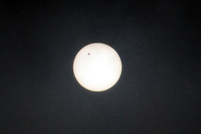The black dot on the sun shows Venus as it travels across the sun in Karachi. - Photo by  Mahjabeen Mankani/Dawn.com