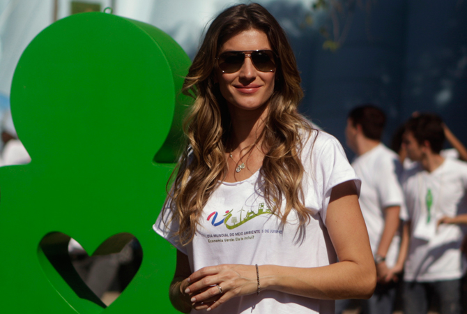 Brazilian model Gisele Bundchen poses before planting a tree during the Green Nation Fest to celebrate World Environment Day in Rio de Janeiro. ? Photo by Reuters