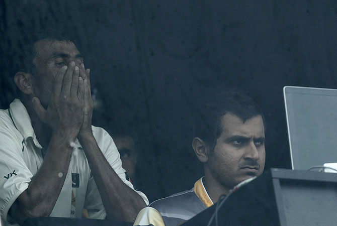 Younis (L) reacts as he watches his dismissal in the dressing room. -Photo by Reuters