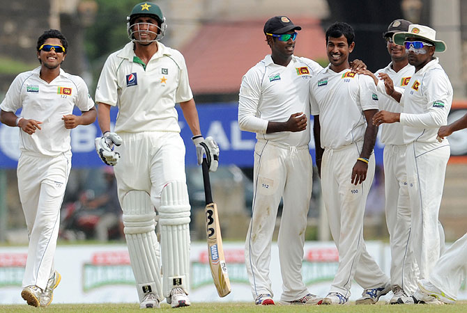 Younis wasn't convinced when he was adjudged caught behind off the bowling of Nuwan Kulasekara. -Photo by AFP