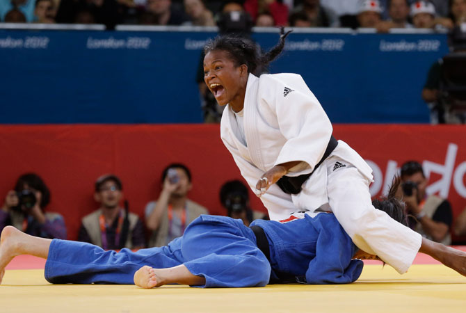 North Korea's An Kae Um competes with Cuba's Acosta Bermoy, right, during the gold medal match in the women's 52-kg judo competition at the 2012 Summer Olympics, Sunday, July 29, 2012, in London. ? Photo by AP