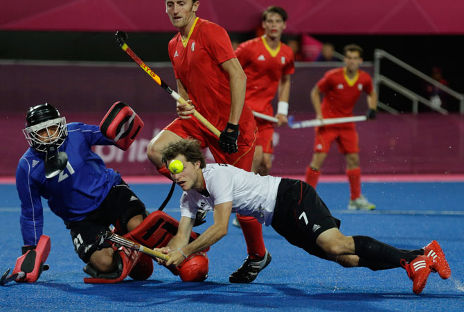 Germany's Oscar Deecke (7) sets his eyes to the ball as he fails to score against Belgium in their men's hockey preliminary match at the 2012 Summer Olympics, Monday, July 30, 2012, in London. Germany won 2-1. ? Photo by AP
