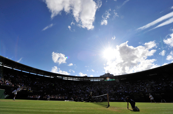 Jo-Wilfried Tsonga of France serves to Lukas Lacko of Slovakia during their men's singles tennis match at the Wimbledon tennis championships. ? Photo by Reuters