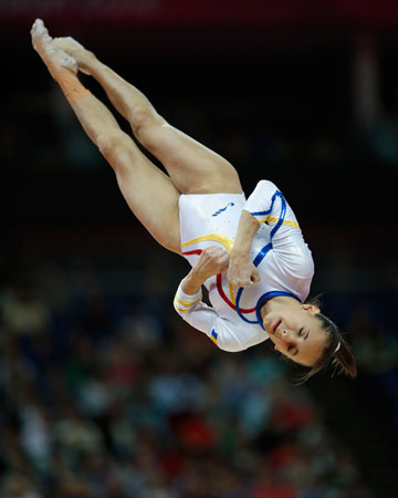 Romania's gymnast Larisa Andreea Iordache performs on the balance beam during the artistic gymnastics women's qualifications at the 2012 Summer Olympics, Sunday, July 29, 2012, in London. ? Photo by AP