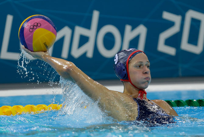Elsie Windes of the United States passes the ball to a teammate as they play Hungary during their women's water polo preliminary round match at the 2012 Summer Olympics, Monday, July 30, 2012, in London. ? Photo by AP