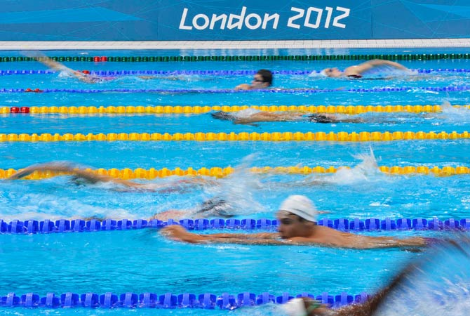 Swimmers train at the Aquatics Centre in the Olympic Park in Stratford in east London July 24, 2012. Photo by Reuters