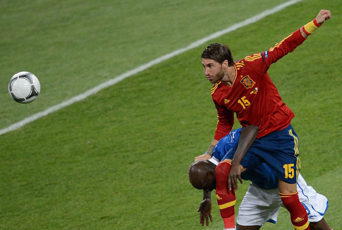 Spanish defender Sergio Ramos heads the ball during the Euro 2012 football championships final. ? Photo by AFP