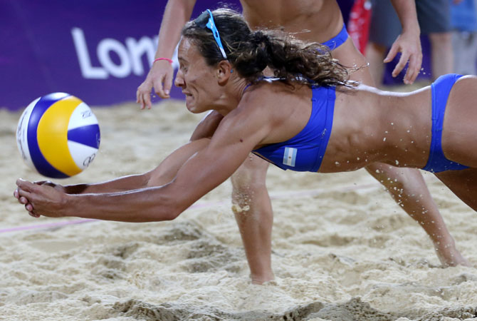 Anna Gallay from Argentina dives for a ball during the Beach Volleyball match against USA at the 2012 Summer Olympics, Sunday, July 29, 2012, in London. ? Photo by AP