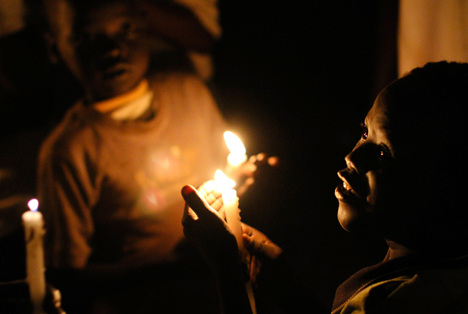 South Sudanese boys holding candles as the clock ticks over to midnight on July 9, 2011 to mark the day that South Sudan will officially declare independence from the north in Juba, the capital of the soon-to-be Republic of South Sudan. – Photo by AFP