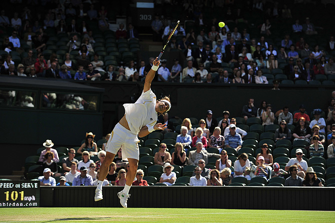 Spain's David Ferrer serves during his third round men's singles match against US player Andy Roddick on day six of the 2012 Wimbledon Championships tennis tournament. ? Photo by AFP