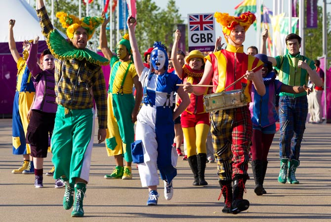 Performers sing during a welcoming ceremony for Team GB in the Olympic Village in London July 24, 2012. Photo by Reuters