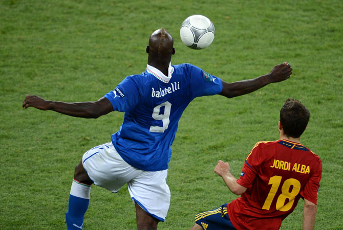 Italian forward Mario Balotelli controls the ball during the Euro 2012 final match Spain vs Italy. ? Photo by AFP