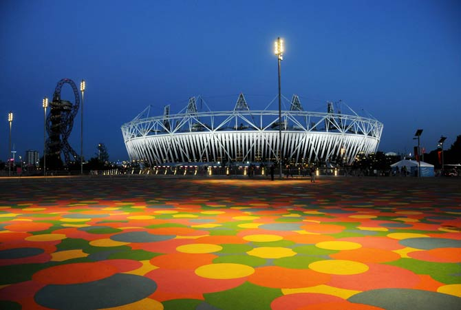 Picture of the Olympic Stadium and the Orbit observation tower (L) at the Olympic Park in London, taken on July 23, 2012 just days ahead of the London 2012 Olympic Games.  Photo by AFP