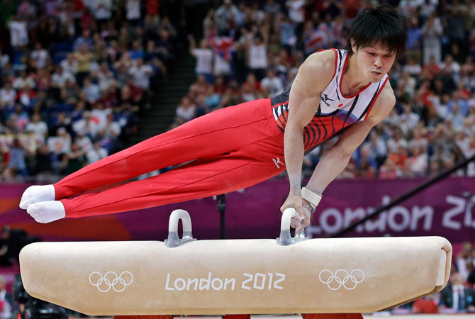 Japanese gymnast Kohei Uchimura performs on the pommel horse during the Artistic Gymnastic men's team final at the 2012 Summer Olympics, Monday, July 30, 2012, in London. After judges spent about five minutes reviewing three-time world champion Uchimura on the pommel horse, his score was revised and Japan was awarded the silver medal with Britain getting bumped down to bronze. ? Photo by AP
