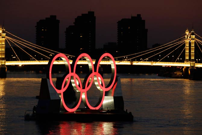 A set of Olympic Rings float on a barge in the River Thames off of Battersea park Tuesday, July 24, 2012, in London. The city will host the 2012 London Olympics with opening ceremonies scheduled for Friday, July 27.  Photo by AP