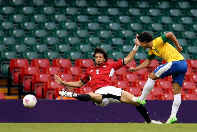 Brazil's Rafael (Right) scores past Egypt's Mahmoud Alaa Eldin during their men's Group C football match at the London 2012 Olympic Games in the Millennium Stadium in Cardiff July 26, 2012. ? Photo by Reuters