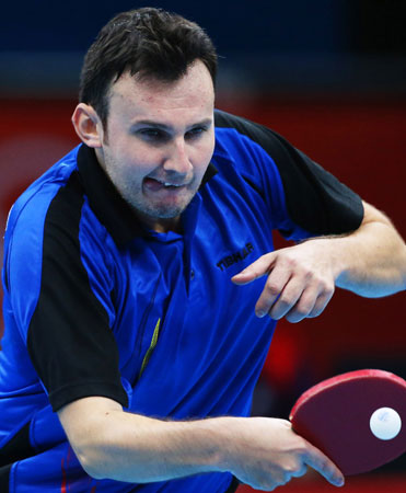 Adrian Crisan of Romania, competes against Timo Boll of Germany, during men's table tennis competition at the 2012 Summer Olympics, Monday, July 30, 2012, in London. ? Photo by AP