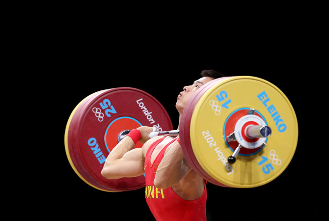 China's Wu Jingbiao competes in the men's 56kg weightlifting competition at the 2012 Summer Olympics, on Sunday, July 29, 2012. ? Photo by AP