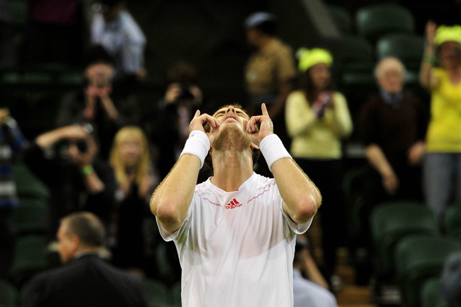Britain's Andy Murray celebrates winning his third round men's singles match against Cyprus's Marcos Baghdatis on day six of the 2012 Wimbledon Championships tennis tournament. Photo by AFP