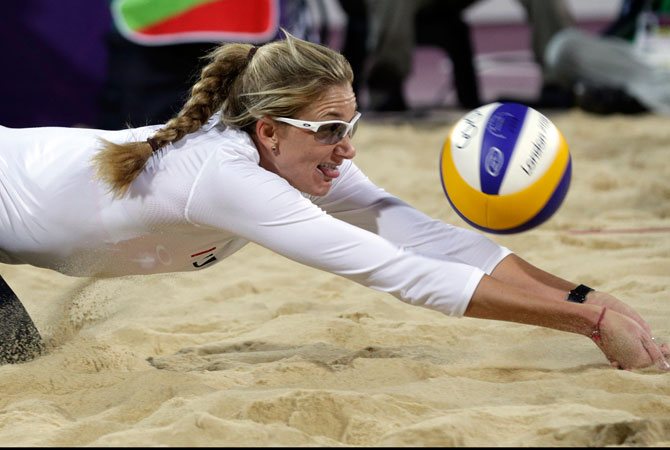 Kerri Walsh of the United States digs out a shot during a beach volleyball match against the Czech Republic at the 2012 Summer Olympics, Monday, July 30, 2012, in London. ? Photo by AP