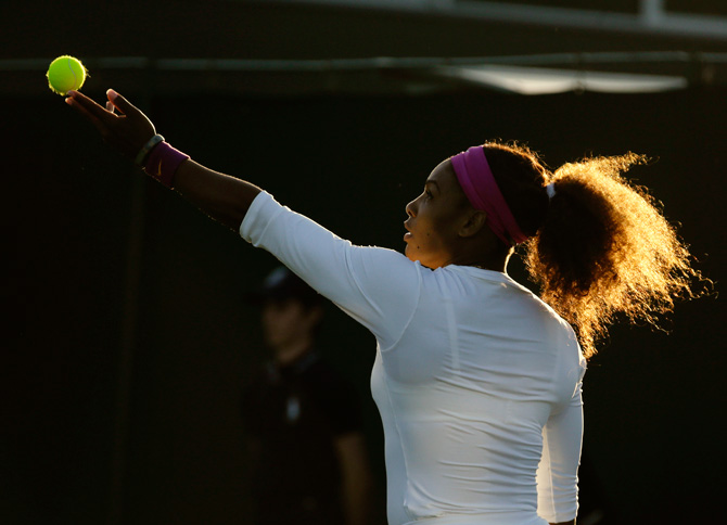 Serena Williams of the United States serves during a second round women's doubles match with her sister Serena Williams against Maria Kirilenko and Nadia Petrova of Russia match at the All England Lawn Tennis. ? Photo by AP