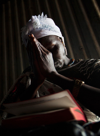 A woman prays during a Sunday service at the Presbyterian Church in Pibor, South Sudan. – Photo by Reuters