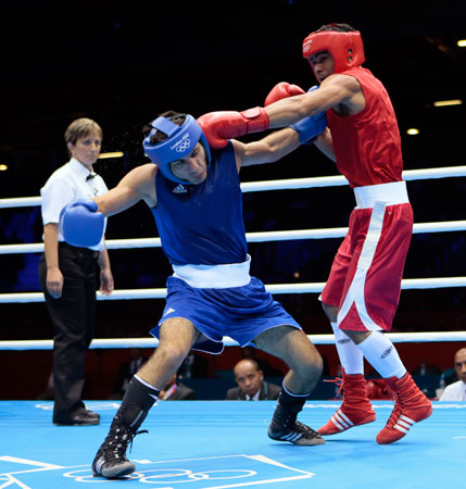 Venezuela's Gabriel Maestre Perez fights Iran's Amin Ghasemi Pour during their men's welterweight 69-kg boxing match at the 2012 Summer Olympics, Sunday, July 29, 2012, in London. ? Photo by AP