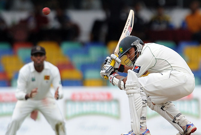 Pakistan cricketer Azhar Ali (R) ducks to avoid a bouncer during the second day of the second Test match between Sri Lanka and Pakistan at the Sinhalese Sports Club (SSC) in Colombo on July 1, 2012. ? Photo AFP
