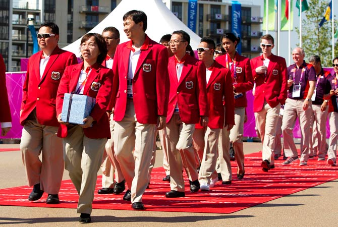 Representatives from Singapore arrive at a welcoming ceremony in the Olympic Village before the London 2012 Olympic Games July 24, 2012. Photo by Reuters
